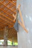Cloth kitbag and wooden angle bar. Hung on wooden pavillion post Royalty Free Stock Image