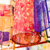 Cloth Lanterns. Panels of thin, transparent, very light richly decorated cloth stitched together and fashioned into a circular and square hollow tubes, finished Royalty Free Stock Images