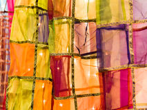 Cloth Latterns. Panels of thin, transparent, very light cloth stitched together with richly decorated borders and fashioned into a tube within which twinkling Stock Image