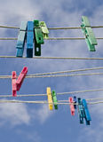 Cloth line with color pegs. Cloth lines with color pegs Royalty Free Stock Images