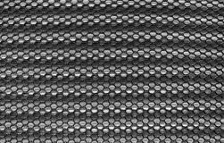 Cloth material fragment as a texture background. Dark gray fishnet cloth material fragment as a texture background Stock Photo