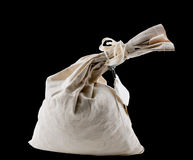 Cloth money bag tied up at neck and isolated Royalty Free Stock Photography