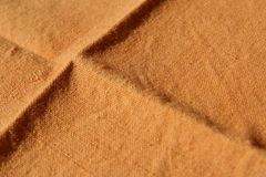 Cloth Napkin. Selective focus on an unfolded cloth napkin Stock Image