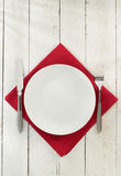 Cloth napkin and plate on wood Stock Photography