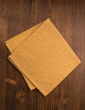 Cloth napkin on wood Royalty Free Stock Images