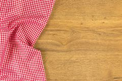 Cloth napkin on wooden background. royalty free stock image