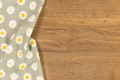 Cloth napkin on wooden background. stock photos