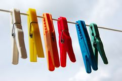 Cloth pegs with a under the sky. Colorful cloth pegs with a under the sky Royalty Free Stock Photography