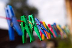 Cloth pegs with a under the sky. Colorful cloth pegs with a under the Stock Photo