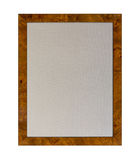 Cloth pinboard in shiny wooden frame. Cloth based pinboard or notice board inside a shiny attractive wood grain picture  frame isolated against white background Stock Image