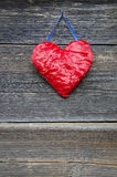 Cloth red heart on ancient wooden house wall Stock Images