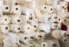 Cloth rolls  in textile store Stock Photos