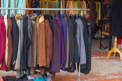 Cloth. Selective focus some used leather clothes hanging on a rack in market royalty free stock image