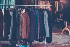 Cloth. Selective focus some used leather clothes hanging on a rack in market. retro picture style royalty free stock image