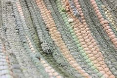 Cloth sewn from multicolored strips of fabric. Needlework, reuse of materials. Textile background. Cloth sewn from strips of fabric. Needlework, reuse of Royalty Free Stock Photography