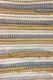 Cloth sewn from strips of fabric. Needlework, reuse of materials. Textile background. Royalty Free Stock Images