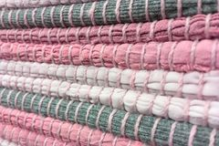 Cloth sewn from strips of fabric. Needlework, reuse of materials. Textile background. Cloth sewn from strips of fabric. Needlework, reuse of materials. Pink Stock Images