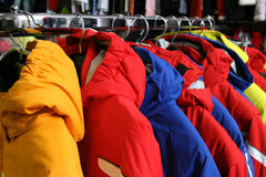 Coats on rack in shop Royalty Free Stock Images