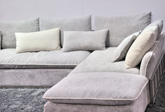 Cloth sofa. In light gray color and carpet, shown as home interior furniture and comfortable, relax life Stock Photos