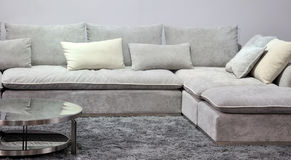 Cloth sofa in living room. Cloth sofa in light gray color and carpet in living room, shown as home interior furniture and comfortable and relax Royalty Free Stock Image