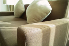 Cloth Sofa's Armrest. A close-up view of a normal cloth sofa's armrest Stock Photo