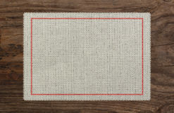 Cloth table edge fabric torn, red stich cross. Border Stock Image