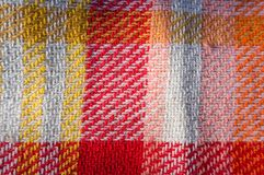 Cloth tablecloth background for pic-nic. With warm colors stock image