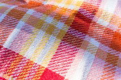 Cloth tablecloth background for pic-nic. With warm colors stock photography