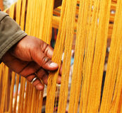 Cloth thread checking in dilli haat shop Stock Images