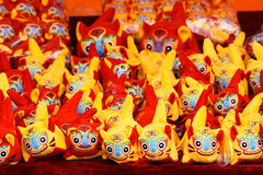Cloth tigers. This year is the Year of the Tiger. People often buy some cartoon tigers to home to celebrate Chinese New Year(Spring Festival). Chinese character Stock Photography