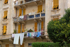 Cloth, towels, fabric sheet after laundry drying hanging outside Royalty Free Stock Images