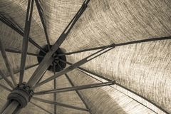 Cloth umbrella. Abstract bamboo and unbleached cloth umbrella Royalty Free Stock Photos