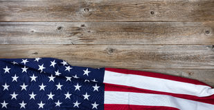 Cloth USA flag on rustic wooden board background Stock Photo