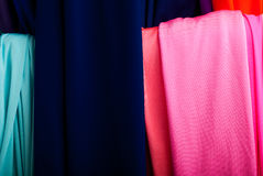 Cloth of various colours on the market. Rolls of textile, cloth and tissue of various colours on the market Stock Photography