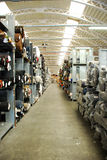 Cloth warehouse. Italian factory that sells worldwide clothes made in italy. In the photo you can see the great stock of fabrics Royalty Free Stock Images