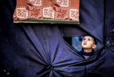 Cloth window from inside the camp. stock photography