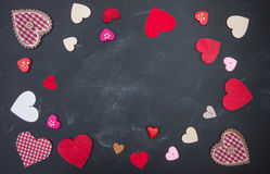 Cloth, wood and paper hearts on rustic wooden table. Royalty Free Stock Image