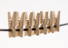 Clothe spins hanging on a rope Royalty Free Stock Images