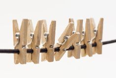 Clothe spins hanging on a rope Stock Photography