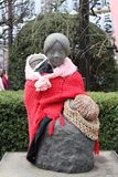 A clothed statue of mother and child near Asakusa Shopping Street Tokyo Japan Stock Image