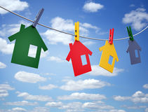 Clothepins and houses on the line Stock Photos