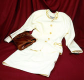 Clothes. White dress with red purse Stock Images