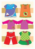 Clothes. For children, both girls. Cute dresses and blouses with applique Stock Image