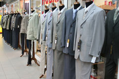 Clothes. Man's costumes on dummies Stock Images