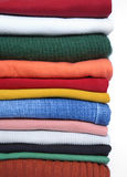Clothes. A pile of colorful clothes on white Royalty Free Stock Photos