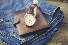 Clothes And Accessories. Watch,wallet and  jeans on table Stock Images