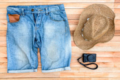 Clothes and accessories on a wooden background Stock Photos