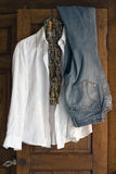 Clothes on antique cabinet Stock Photo