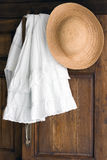 Clothes on antique cabinet Stock Image