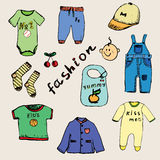 Clothes for baby boy set hand drawn sketch, colored and outlined Stock Photography